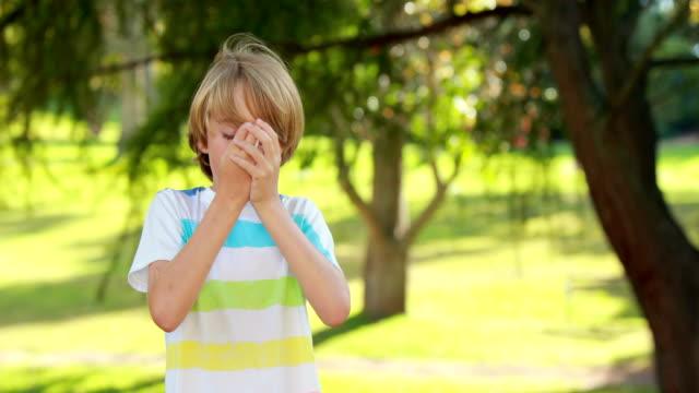 Little boy using his inhaler in the park video