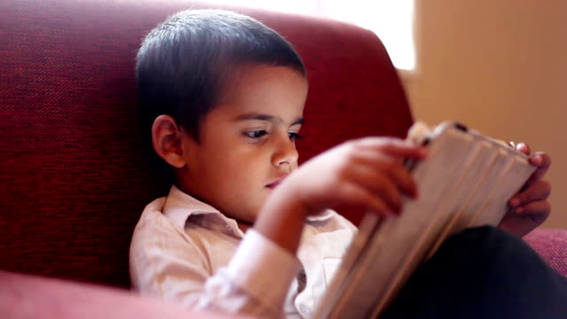 Little boy using ipad at night video