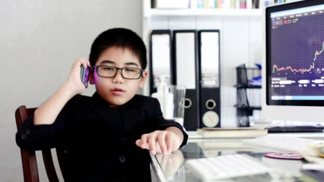 Little boy using smartphone video
