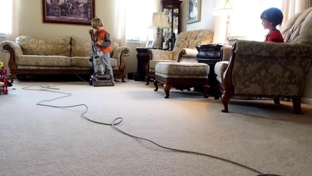 Little Boy Vacuuming Floor video