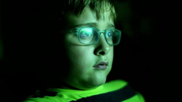 Little boy watching TV at night video