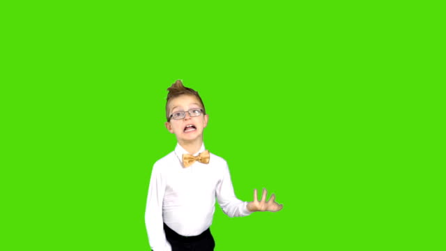 Little boy wearing gold bow tie has fun at chroma key background video