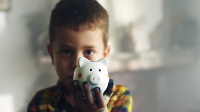Little Boy With Piggy Bank Little Boy Showing Piggy Bank piggy bank stock videos & royalty-free footage