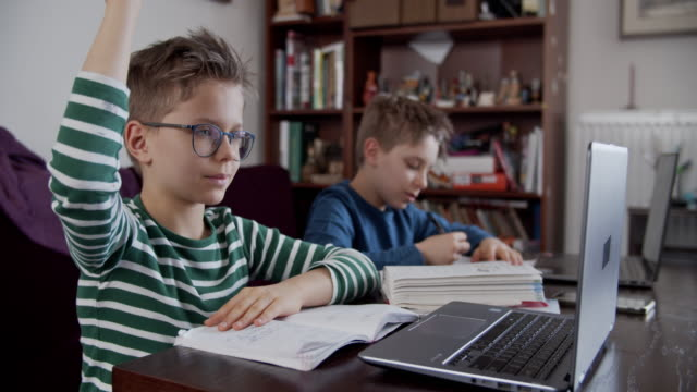 little boys attending to online school class. - teacher stock videos & royalty-free footage