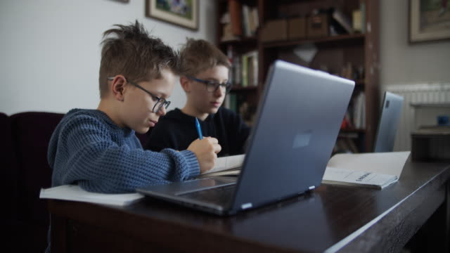little boys attending to online school class. - online learning stock videos & royalty-free footage