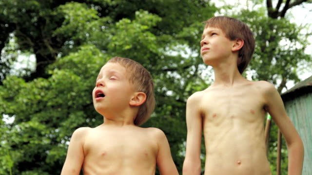Little boys look up in the sky. video
