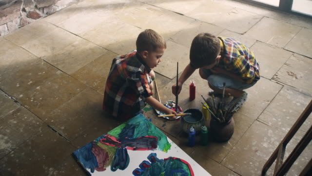 Little boys painting at the artist's studio video