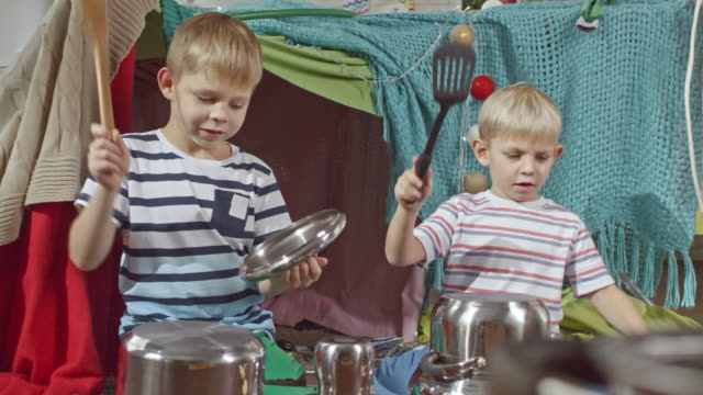 Little Boys Playing Music on Pots video