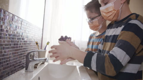 Little boys washing hands thoroughly Little boys washing hands in bathroom very thoroughly.  Boys are wearing face masks. Nikon D850 covid stock videos & royalty-free footage