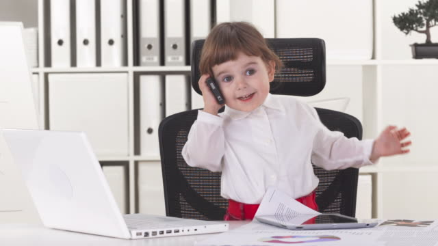 HD: Little Business Girl Talking On Phone  one girl only stock videos & royalty-free footage
