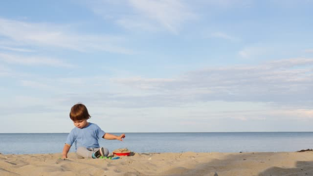 little child play on beach - eastern european descent stock videos & royalty-free footage