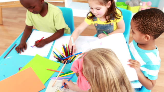 Little children drawing together in class video