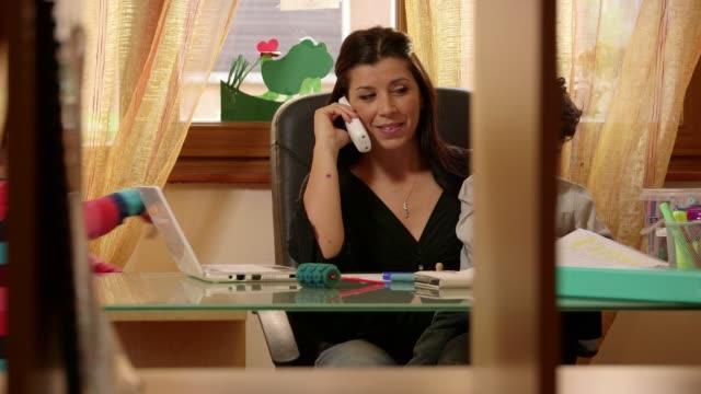 Little children, girl, boy, woman, businesswoman, business, multitasking mother working video