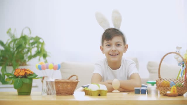 Little cute and adorable boy is smiling sincerely. Boy is pumping over. Concept Easter holiday.