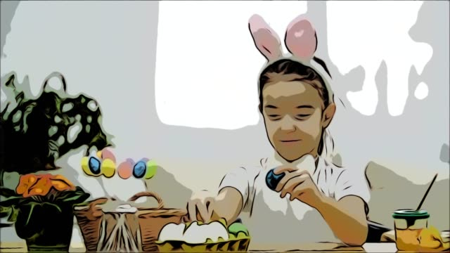 Little cute and adorable girl is smiling and playing with colorful chicken's eggs in his hands. Concept Easter holiday.