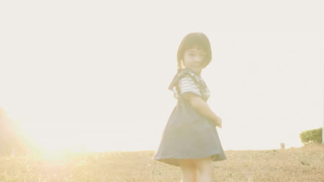 Little cute asian baby girl is running to the nature with sunlight effect in the evening video