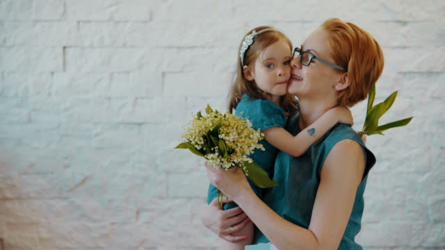 little daughter hug each other with flowers video