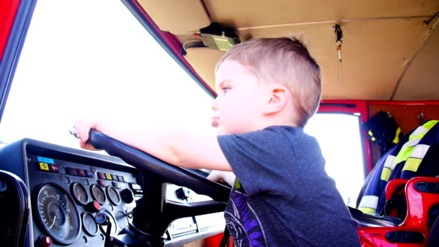 little fireman - firefighter stock videos and b-roll footage
