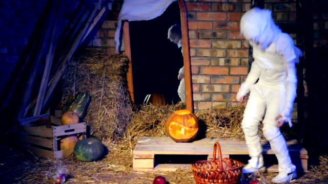 Little Ghost Picking Up Apples At Halloween Holiday video