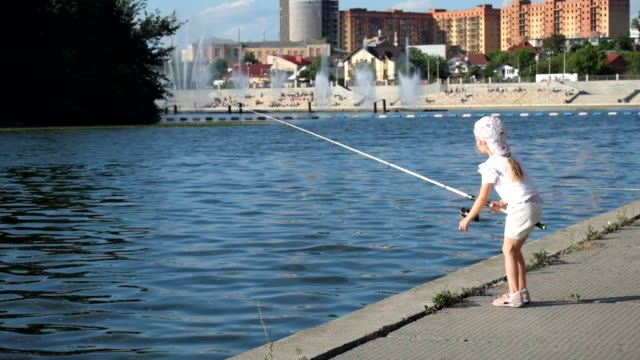 Little girl actively fishing with a spinning reel video