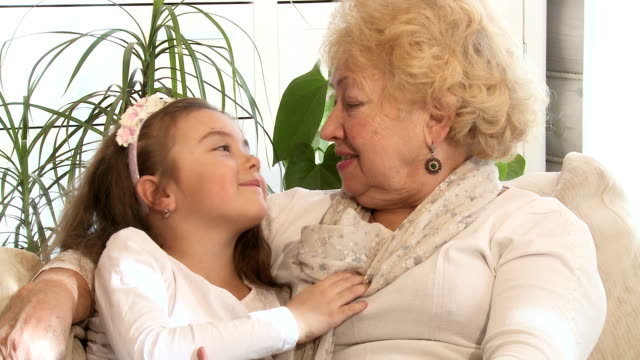 Little girl and her grandmother indoors video