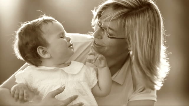 HD SLOW-MOTION: Little Girl And Her Mother  sepia toned stock videos & royalty-free footage