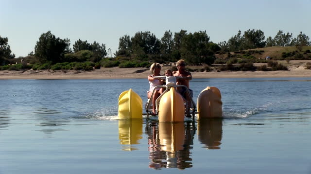 Little girl and parents landing water bike on bay video