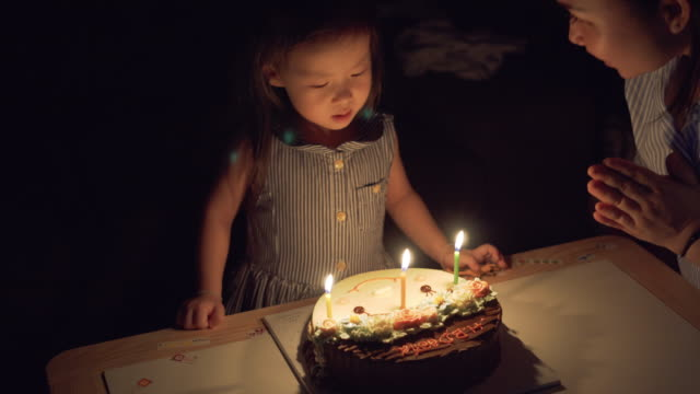 Little girl blowing candle birthday 3 years old video