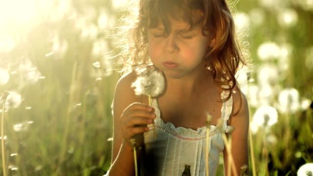 SUPER SLO-MO Little Girl Blowing Dandelion video