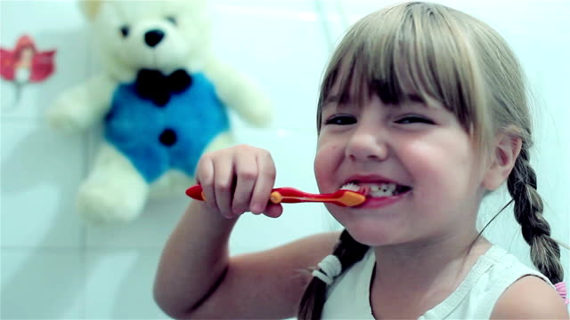 Little girl brushing her teeth video