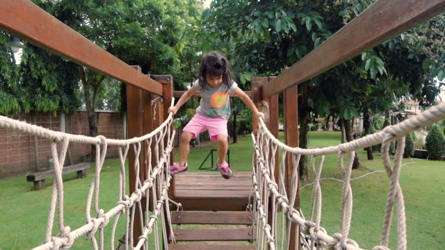 A Little girl Climbing on Ropes at Playground video