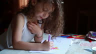 istock Little girl coloring a picture in the sketchbook 1297209903