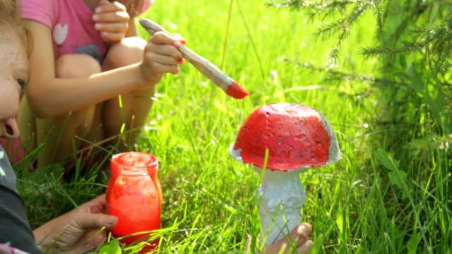 Little girl coloring garden decoration