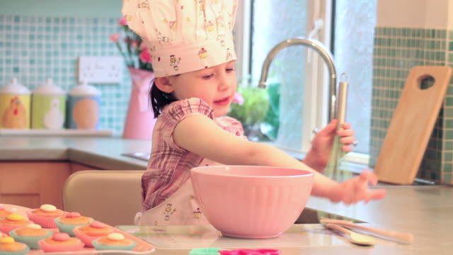 Little Girl cooking in kitchen video
