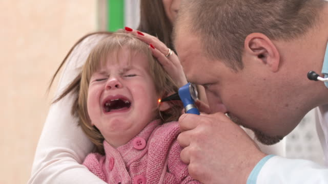 HD: Little Girl Crying During Doctors Examination video