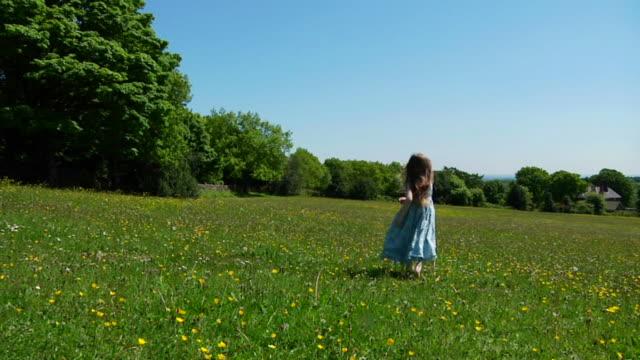 SLOW MOTION: Little girl dancing in meadow video