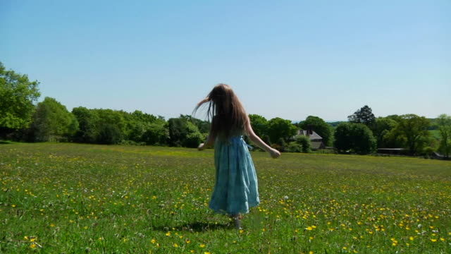 SLOW MOTION: Little girl dancing in meadow video
