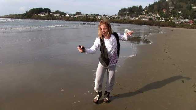 Little girl dancing on beach and spinning video