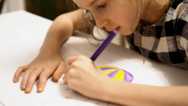 Little girl drawing with pencil at home. video