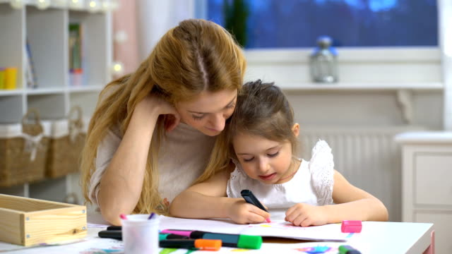 Little girl draws in the nursery video