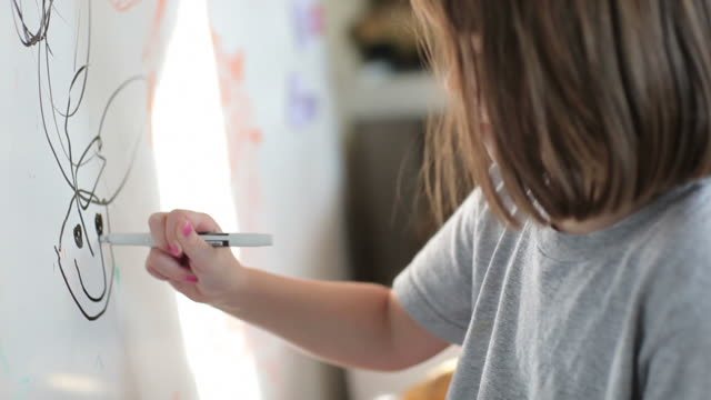 Little Girl Draws on White Board  playroom stock videos & royalty-free footage