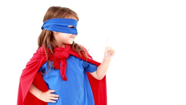 liten flicka utklädd superhjälte - superhjälte isolated bildbanksvideor och videomaterial från bakom kulisserna