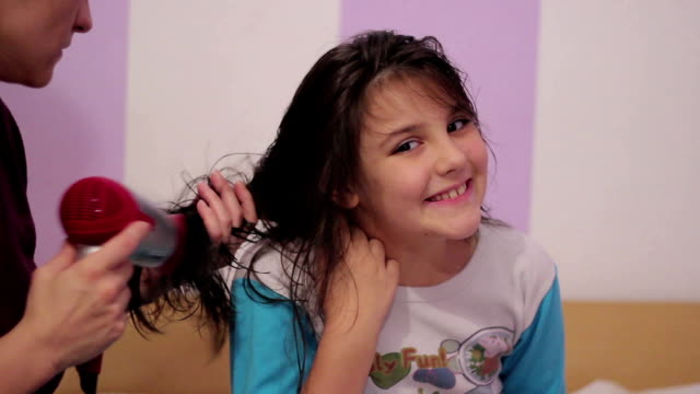 little girl dries hair video