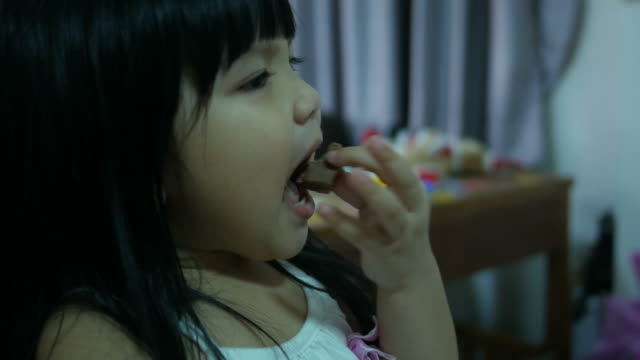 Little girl Eating chocolate video