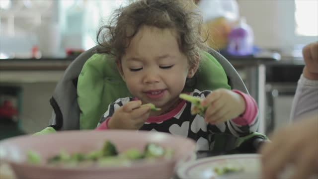 little girl eating her breakfast - vegan stock videos and b-roll footage