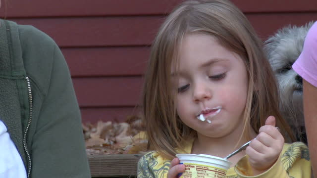 Little girl eating yogurt 720p30 video