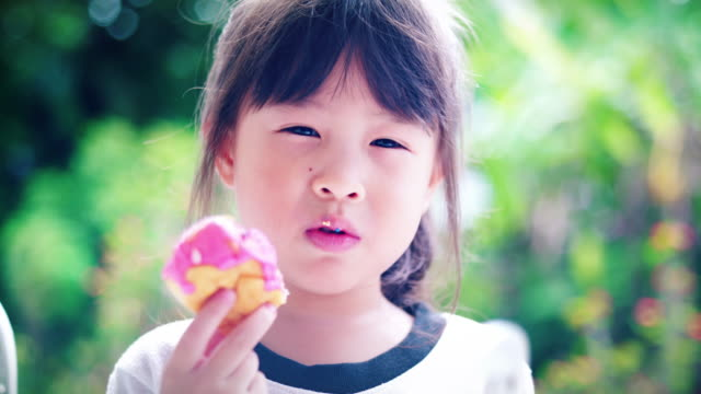 Little Girl Eating Yummy donut. video