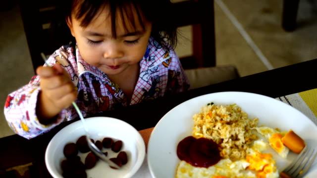 Little Girl Eats for breakfast video
