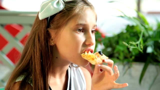 Little Girl Eats Pizza video