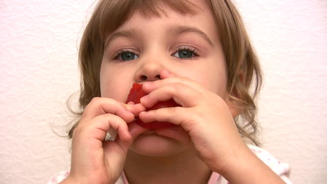 Little girl eats tomato video